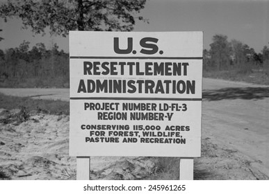 US Resettlement Administration sign for the Withlacoochee Land Use Project. Reforested the area established recreation facilities fire control and telephone communications. Florida Jan 1937.