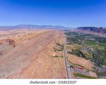 US Route 191 and La Sal Mountains aerial view near Arches National Park, Moab, Utah, USA.