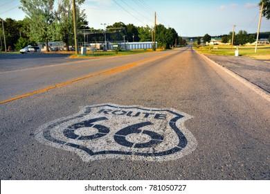 U.S. Route 66 highway, with sign on asphalt on Missouri.