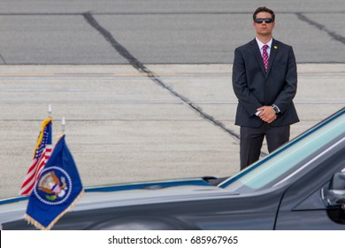A U.S. Secret Service agent stands guard during the arrival of President Donald Trump aboard Air Force One in Ronkonkoma, NY, Friday, July 28, 2017.