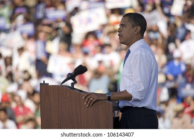 US Senator Barack Obama speaking from podium at Early Vote for Change Presidential rally, October 25, 2008 at Bonanza High School, Judy K. Cameron Stadium in Las Vegas, NV