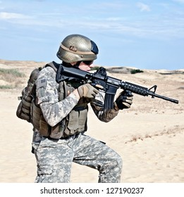 US soldier going through the desert during the military operation