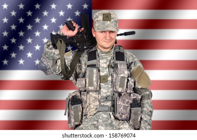 us soldier with his assault rifle on flag background