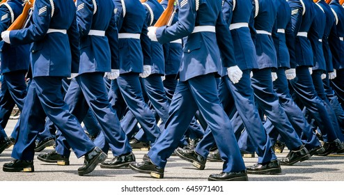 US soldiers in dress uniforms march in a Memorial Day parade. Close up detail. Location: Washington DC