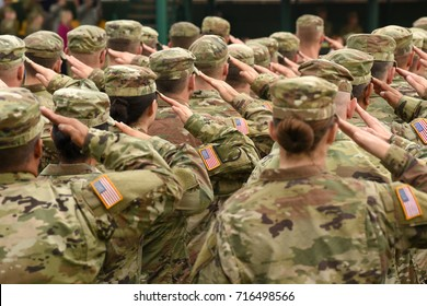 US soldiers giving salute - Shutterstock ID 716498566