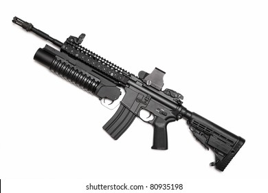 US Spec Ops M4A1 assault rifle with RIS/RAS, grenade launcher and tactical holographic sight. Isolated on a white background. Weapon series.