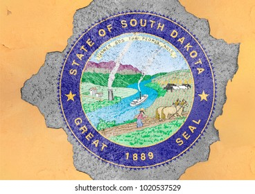 US state South Dakota seal flag painted on concrete hole and cracked wall facade structure