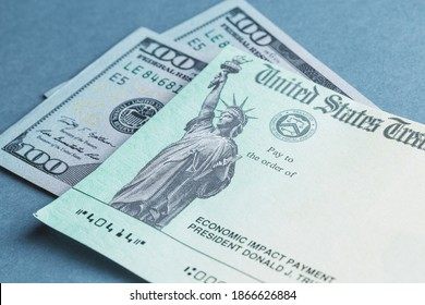 A US stimulus check with some one-hundred-dollar bills