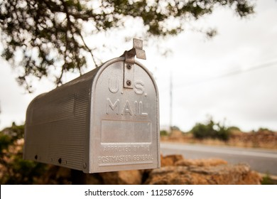 U.S. style metal mailbox photographed in flight perspective with the background blurred