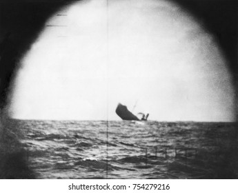 U.S. submarine periscope photo of Japanese cargo vessel 3.5 minutes after being torpedoed. May 5, 1943. World War 2