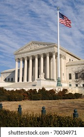 US Supreme Court Building with United States Flag