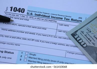 US tax form, dollar cash, pen, calculator, finance accounting and tax season concept