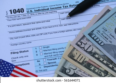 US tax form, dollar cash, pen, calculator, finance accounting and tax season concept