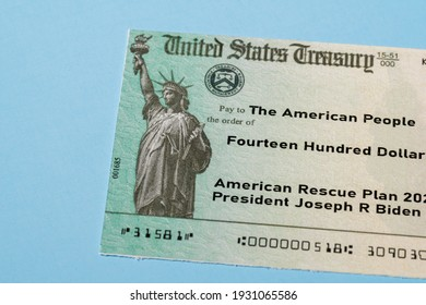 US Treasury illustrative check to illustrate American Rescue Plan Act of 2021 payment on blue background