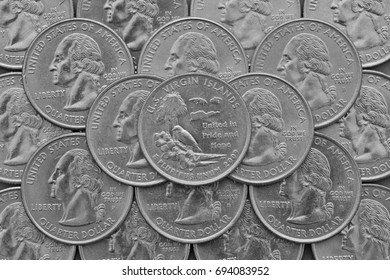 U.S. Virgin Islands State and coins of USA. Pile of the US quarter coins with George Washington and on the top a quarter of U.S. Virgin Islands State.