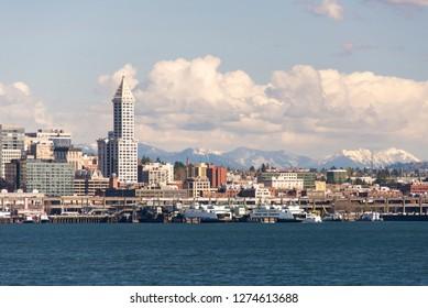 US, WA, Seattle waterfront, ferry terminal, Smith Tower Cascade Mountains
