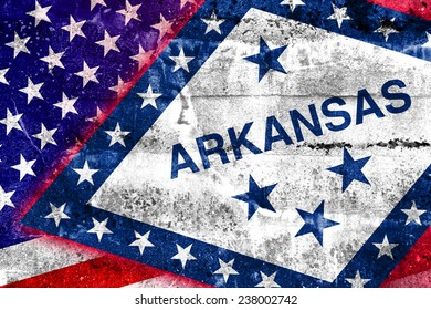 USA and Arkansas State Flag painted on grunge wall