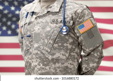 USA Army doctor with stethoscope over his neck and USA flag on background