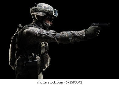 USA Army soldier (ISAF) with rifle(motion effect). Shot in studio on grey background
