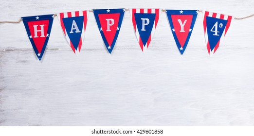 USA banner for happy Fourth of July holiday on rustic white wood.