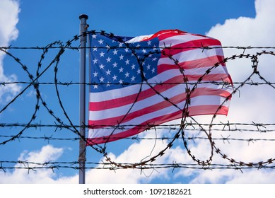 USA Border with American Flag and barbed Wire