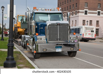 USA, BUFFALO - OCTOBER 21: Big towing truck in 2013 in the street. Frontal view.