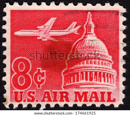 1963 United States Postage Stamp In The Value Of 8c Used For Overseas Air Mail Deliveries Showing A Jet Flying Over Capitol Building