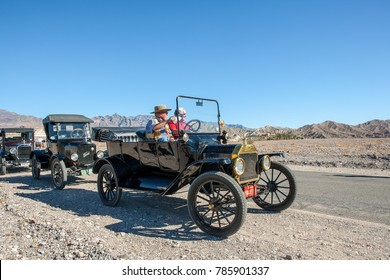 USA, CA, DEATH VALLEY - CIRCA NOV 2008 - Death Valley 49ers Antique Cars, Ford Horseless carriage with two people driving