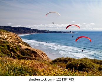 USA, California, La Jolla. Paragliders float toward La Jolla Shores