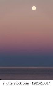 USA California Moonset over Pacific Ocean