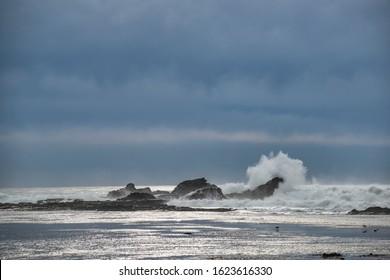 USA, California, San Mateo County, Half Moon Bay. Large waves crash against the rocks during a storm at the famous surf spot the Mavericks.