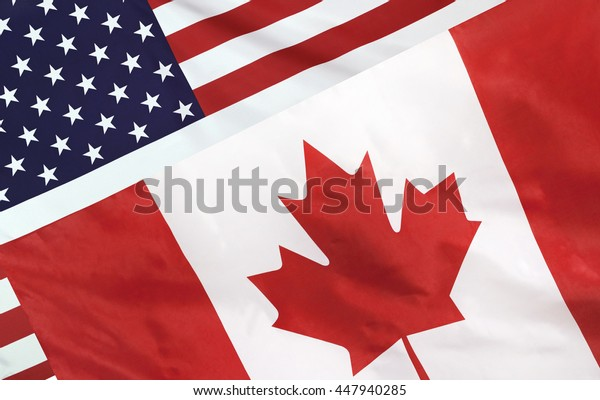 USA and Canada relations concept with diagonally merged real fabric flags