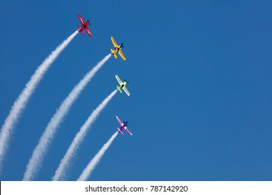 USA, Chicago - August 19: Matt Chapman lead with The Extra 330LX at Chicago Air and Water Show, with smoke to track the high flying planes on August 19, 2017