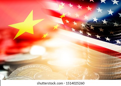 USA and China flag on coins stacking .It is symbol of economic tariffs trade war and tax barrier between United States of America and China.