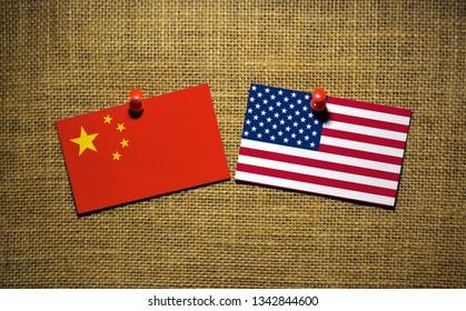 USA and China flag on sackcloth Background