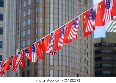 USA and China flags hanging in front of business building