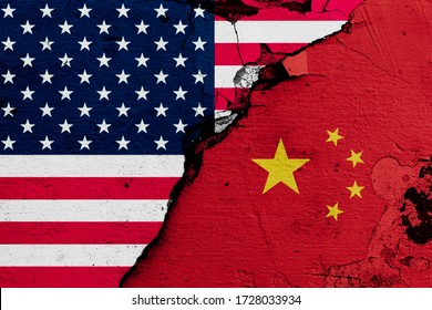 U.S.A. and China's flags on cracked wall (Concept of international conflict) - Shutterstock ID 1728033934