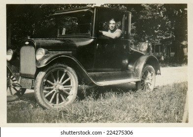 USA- CIRCA 1920s: Vintage photo shows the man behind the wheel of a car.