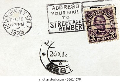 USA - CIRCA 1925. A postage stamp printed in USA shows image portrait of President Abraham Lincoln. Vintage postmark from New York on an old post card, circa 1925