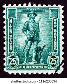 "USA - CIRCA 1942: A stamp printed in USA from the ""War savings"" issue shows Minuteman statue, circa 1942."