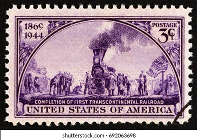 USA - CIRCA 1944: A stamp printed in USA issued for the 75th anniversary of first Transcontinental Railway shows Golden Spike Ceremony (mural, John McQuarrie), circa 1944.