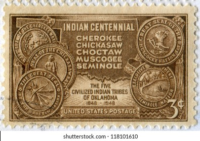 USA - CIRCA 1948: a stamp printed in the United States shows Map of Indian Territory and Seals of Five Civilized of Oklahoma Tribes. Indian centennial. Scott catalog A419, circa 1948