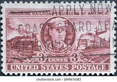 """USA - Circa 1950 : a postage stamp printed in the US showing a portrait of John Luther """"Casey"""" Jones, who was killed in a train wreck near Vaughn, Mississippi Text: Railroad Engineers of America"""
