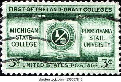 USA - CIRCA 1955: A stamp printed in United States of America shows coat of arms of Michigan State College, Pennsylvania University, First of the Land-Grant Golleges, circa 1955