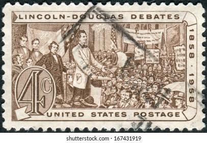 USA - CIRCA 1958: Postage stamp printed in the USA, shows Abraham Lincoln and Stephen A. Douglas Debating, circa 1958