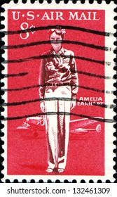 USA - CIRCA 1963: A stamp printed in United States of America shows Amelia Earhart and  Lockheed Electra, circa 1963