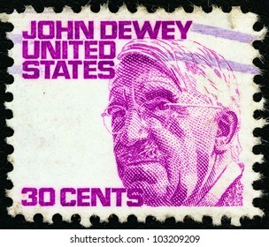 """USA - CIRCA 1965: A stamp printed in USA from the """"Prominent Americans (1st series)"""" issue shows philosopher John Dewey, circa 1965."""