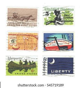 USA - CIRCA 1967 - 1968: Used postage stamps printed in USA,  Stern of Erie Canal, Cherokee Strip of Kansas, Davy Crockett and Daniel Boone, Marquette explorer and the Fort Moultrie Flag