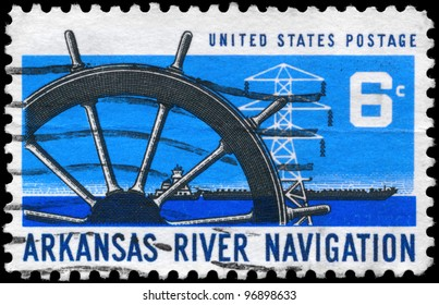 USA - CIRCA 1968: A Stamp printed in USA shows the Ship�¢??s Wheel, Power Transmission Tower & Barge, Arkansas River Navigation Issue, circa 1968