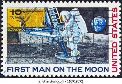 """USA - CIRCA 1969: A stamp printed in USA from the """"1st Man on the Moon"""" issue shows  Neil Armstrong setting foot on Moon, circa 1969."""